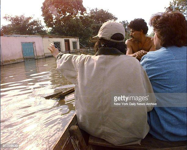 Bianca Jagger and Daily News reporter Carolina Gonzales ride in boat up a street flooded when Hurricane Mitch hit Tipitapa north of Managua Nicaragua...
