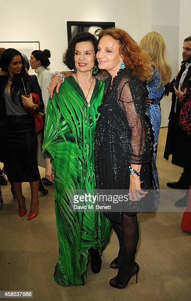 Bianca Jagger and Diane Von Furstenberg at the Diane Von Furstenberg Journey Of A Dress exhibition at Phillips Gallery on November 6 2014 in London...