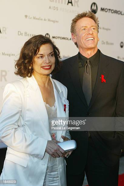 Bianca Jagger and fashion designer Calvin Klein arrive at the Moulin de Mougins restaurant to attend an annual AIDS benefit during the 55th annual...