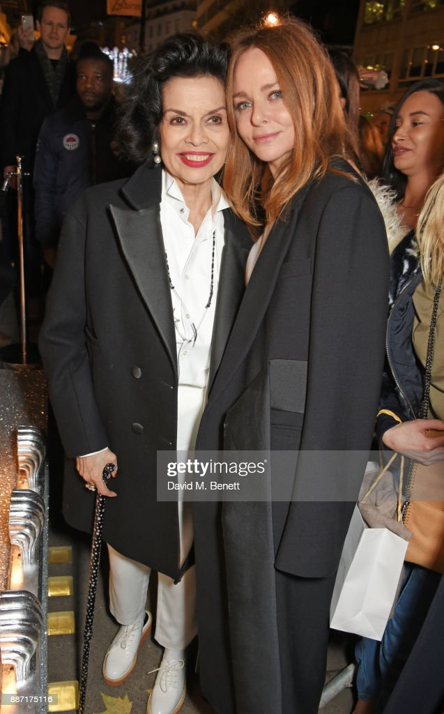 Bianca Jagger (L) and Stella McCartney attend the Stella McCartney Christmas Lights 2017 party on December 6, 2017 in London, England.
