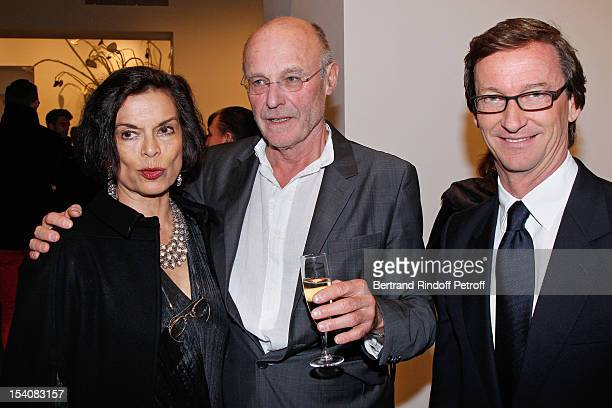Bianca Jagger artist Anselm Kiefer and Thaddaeus Ropac attend the opening of Ropac's new gallery on October 13 2012 in Pantin France