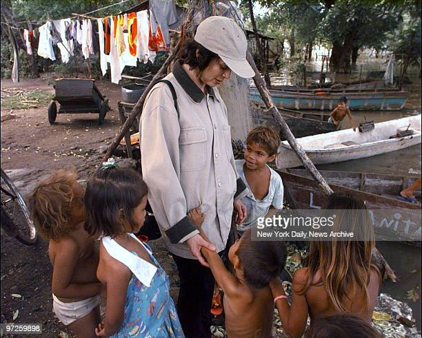 Bianca Jagger greets children now living in their school as a result of floods caused by Hurricane Mitch in Tipitapa north of Managua Nicaragua...