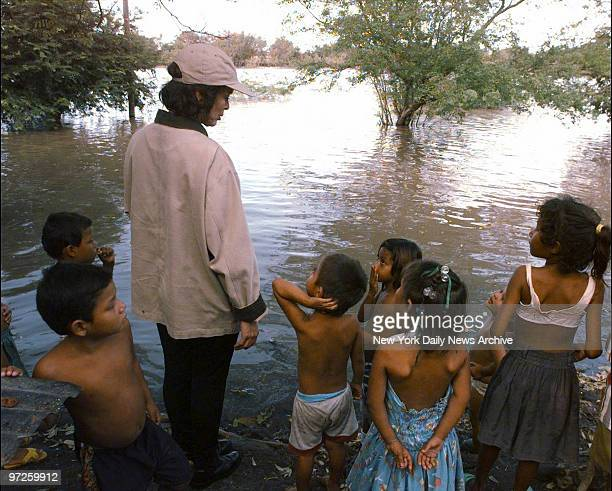 Bianca Jagger stands with children now living in their school as a result of floods caused by Hurricane Mitch in Tipitapa north of Managua Nicaragua...