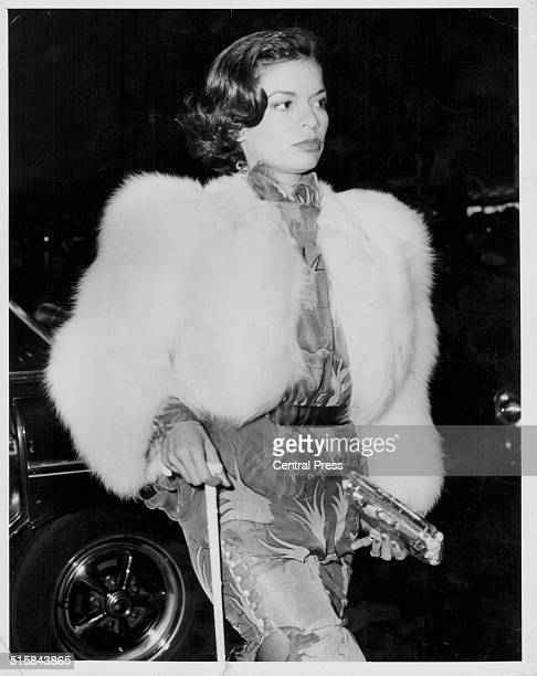 Bianca Jagger wife of musician Mick Jagger wearing a white fur coat as she arrives at Odeon Leicester Square for the premiere of the film 'Don't Look...