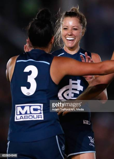 Bianca Jakobsson of the Blues congratulates Darcy Vescio of the Blues on a goal during the 2017 AFLW Round 01 match between the Carlton Blues and the...