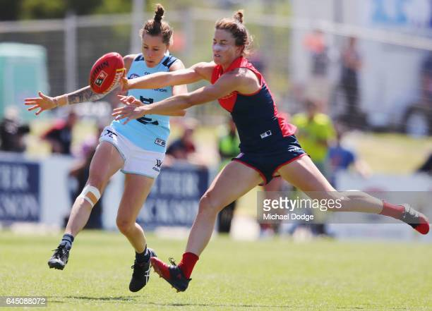 Bianca Jakobsson of the blues kicks the ball during the round four Women's AFL match between the Melbourne Demons and the Carlton Blues at Casey...