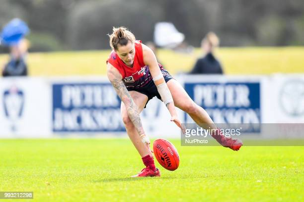 Bianca Jakobsson of the Casey Demons picks up the ball during the VFL Women's round 9 game between the Casey Demons and Southern Saints at Casey...