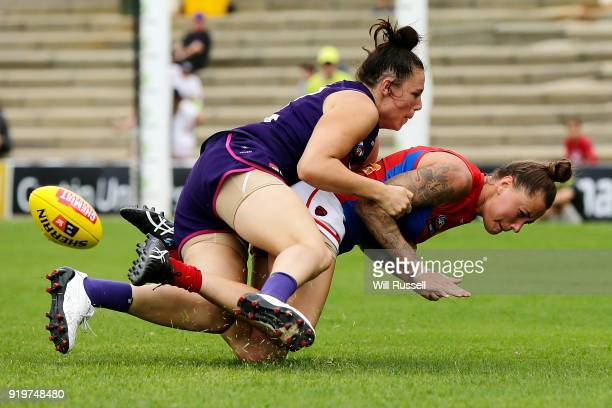 Bianca Jakobsson of the Demons is tackled by Ashlee Atkins of the Dockers during the round three AFLW match between the Fremantle Dockers and the...