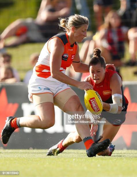 Bianca Jakobsson of the Demons is tackled by Cora Staunton of the Giants during the 2018 AFLW Round 01 match between the Melbourne Demons and the GWS...