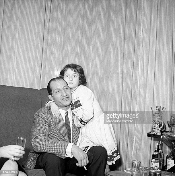 Bianca Maria Balti hugging her father, Italian racing cyclist Gino Bartali. Florence, 1960s.