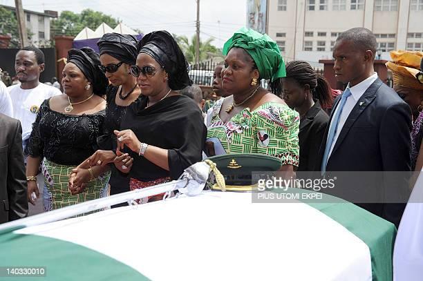 Bianca OdumegwuOjukwu flanked by family members walks past the body of her late husband and Nigeria's secessionist leader Odumegwu Ojukwu during the...