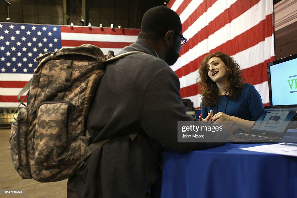 Bianca Pasternack (R) assists U.S. Army veteran Adrian Anderson, who served in both Iraq and Afghanistan, at the Hiring Our Heroes military job fair held on March 27, 2013 in New York City. Hundreds of veterans and their spouses turned out to meet more than 100 employers participating at the second annual event, hosted by the U.S. Chamber of Commerce National Chamber Foundation. Lead sponsors were Capital One Financial Corporation and Toyota.