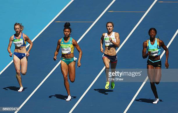Bianca Razor of Romania Emily Diamond of Great Britain Morgan Mitchell of Australia and Shaunae Miller of the Bahamas competes in round one of the...