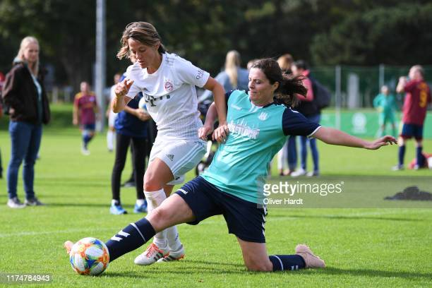 Bianca Rech of FC Bayern Muenchen competes for the ball with Maike Ertel of Team Hamburg on Day 2 of the DFB Over40 And Over50 Cup between FC Bayern...