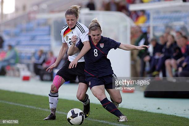 Bianca Schmidt of Germany and Amy Rodriguez of USA battle for the ball during the Women Algarve Cup match between Germany and USA on March 3, 2010 in...