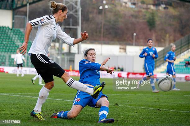 Bianca Schmidt of Germany competes for the ball with Andrea Vrabcova of Slovakia during the FIFA Women's World Cup 2015 Qualifier between Slovakia...