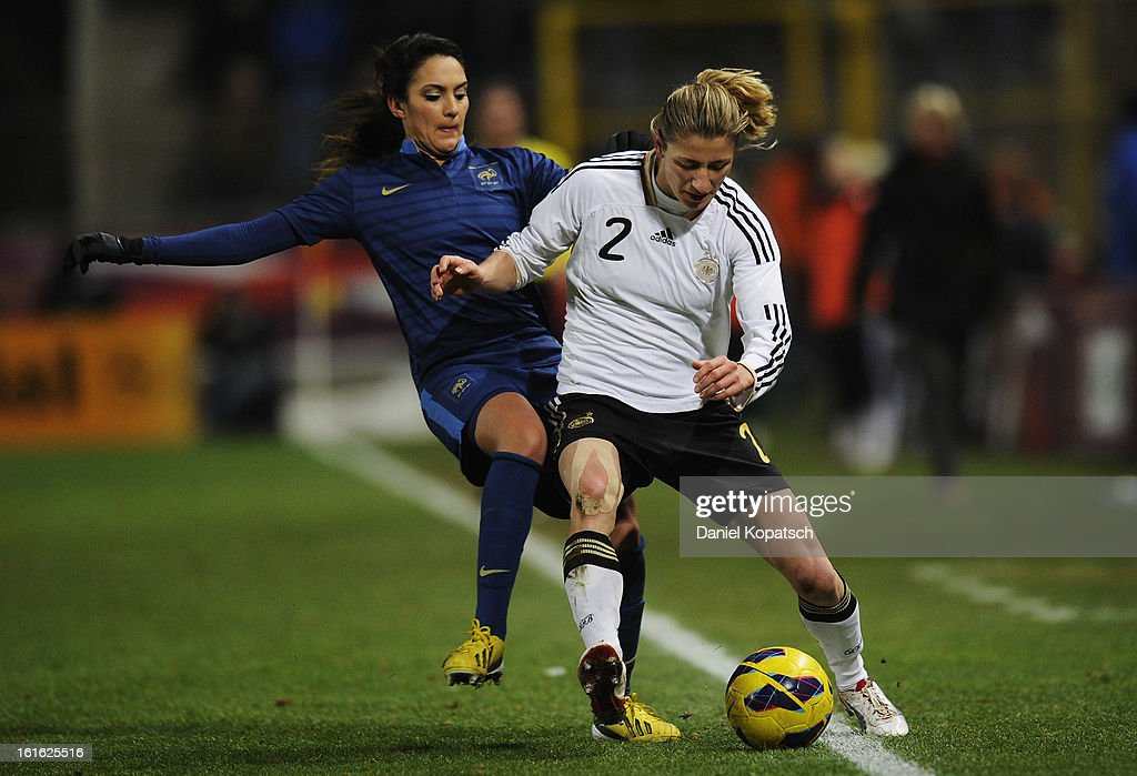 Bianca Schmidt of Germany (R) is challenged by Louisa Necib of France during the international friendly match between France and Germany at Stade de la Meinau on February 13, 2013 in Strasbourg, France.