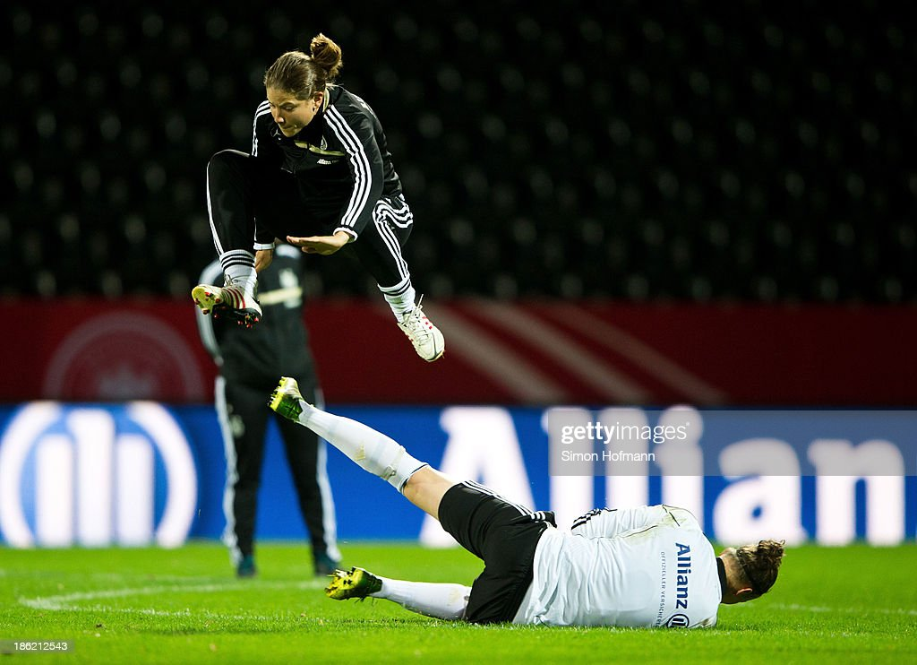 Bianca Schmidt of Germany tries to score against goalkeeper Almuth Schult of Germany during a Germany training session at Volksbank Stadion on October 29, 2013 in Frankfurt am Main, Germany.