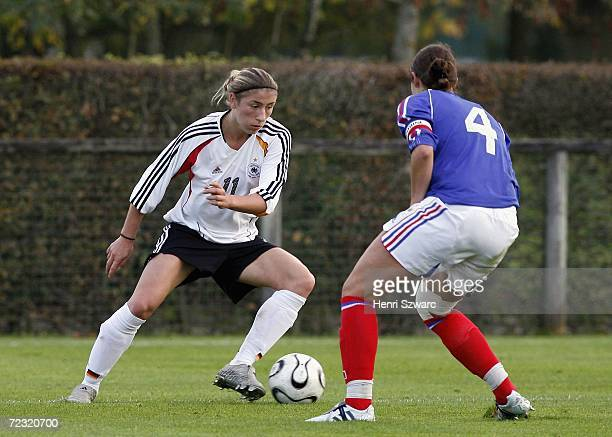 Bianca Schmidt of Germany vies for the ball against Audrey Fevrier of France during the Women's U17 international friendly match between France and...