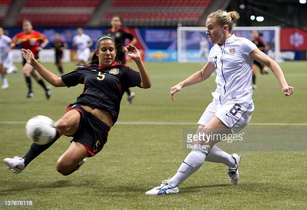 Bianca Sierra of Mexico tries to block the cross of Amy Rodriguez of the United States during first half of the 2012 CONCACAF Wome's Olympic...