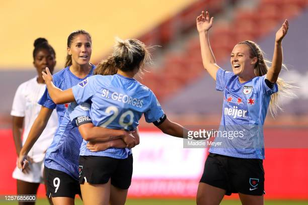 Bianca St. Georges of Chicago Red Stars celebrates with her teammates Rachel Hill, Savannah McCaskill and Katie Johnson after scoring a goal in the...