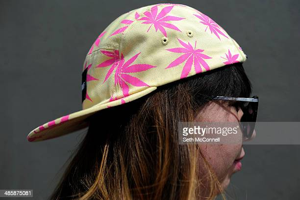 Bianca Torres of Chicago Illinois wears a pot themed hat during the High Times Cannabis Cup at Denver Mart in Denver Colorado on April 20 2014 Event...