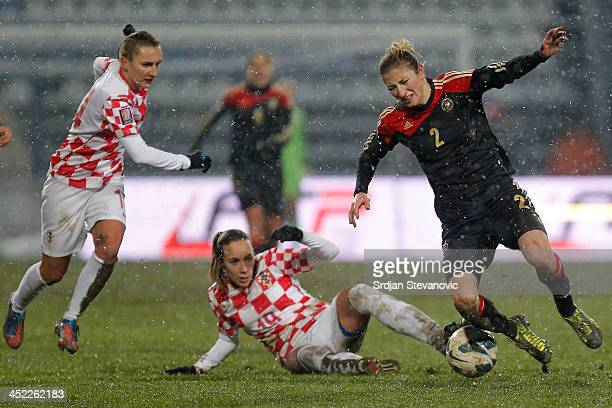 Bianca Ursula Schmidt of Germany is challenged by Sandra Zigic of Croatia during the FIFA Women's World Cup 2015 Qualifier between Croatia and...