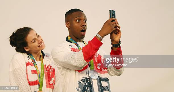 Bianca Walkden and pose with Lutalo Muhammad of Great Britain during a Rio 2016 Victory Parade for the British Olympic and Paralympic teams on...