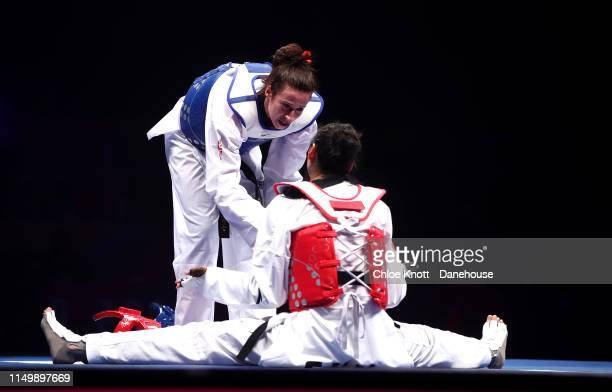 Bianca Walkden comforts Shuyin Zheng of China the Final of the Women's 73kg division at The World Taekwondo Championships at Manchester Arenaon May...