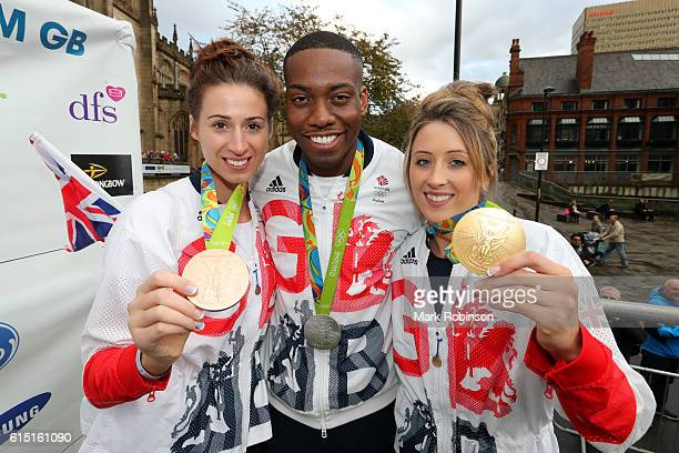Bianca Walkden Jade Jones pose with Lutalo Muhammad of Great Britain during a Rio 2016 Victory Parade for the British Olympic and Paralympic teams on...