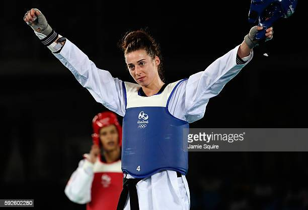 Bianca Walkden of Great Britain celebrates after defeating Wiam Dislam of Morocco during the Women's 67kg Bronze Medal contest on Day 15 of the Rio...