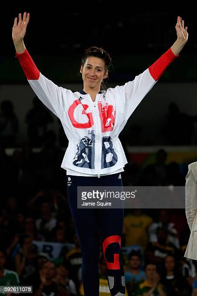 Bianca Walkden of Great Britain celebrates on the podium during the medal ceremony for the Taekwondo Women 67kg Gold Medal Contest on Day 15 of the...