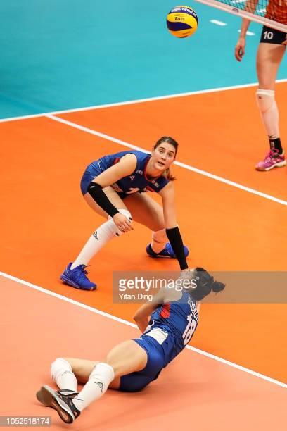 Bianka Busa and Tijana Boskovic of Serbia in action during the FIVB Women's World Championship semi final between Serbia and Netherlands at Yokohama...
