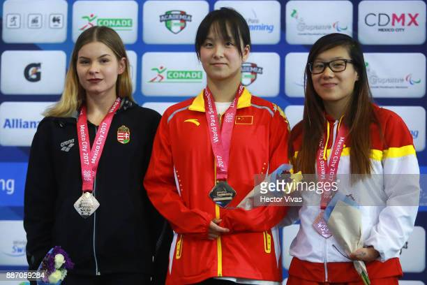 Bianka Pap of Hungary silver medal, Yi Chen of People's Republic of China gold medal and Isabel Hernandez bronze medal in Women's 200 m Individual...