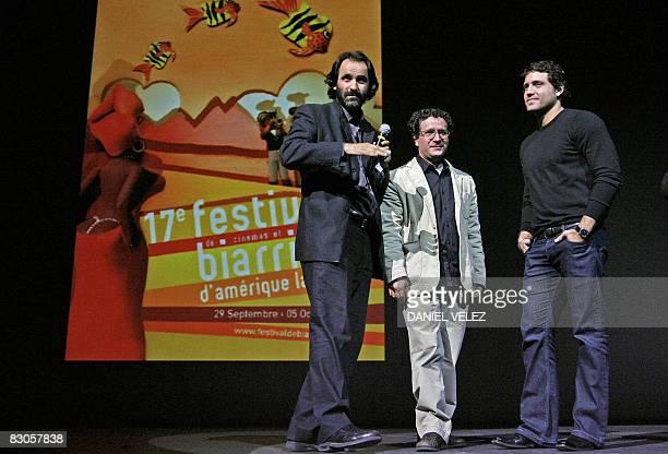 Biarritz Latin American film festival scheduler JeanChristophe Berjon introduces Venezuela's film director Alberto Arvelo next to Venezuela's actor...