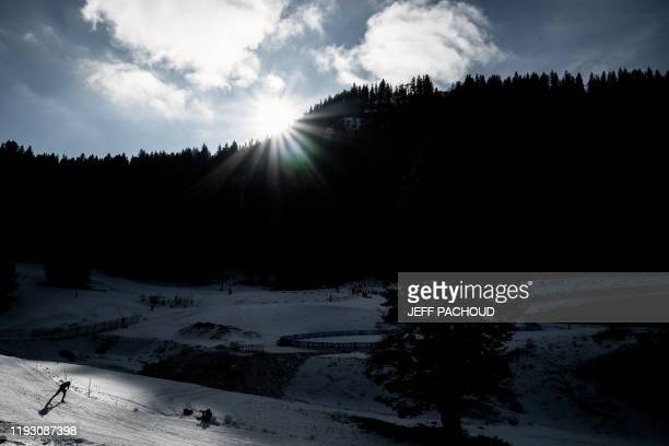 A biathlete competes in the individual men's biathlon 2020 Lausanne Winter Youth Olympic Games event at Premanon on January 11 2020