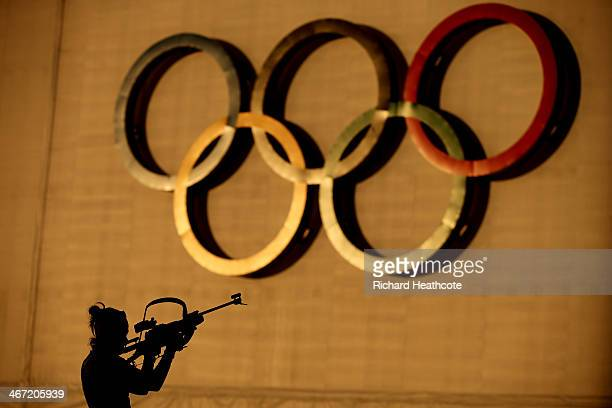A biathlete shoots during a training session ahead of the Sochi 2014 Winter Olympics at the Laura CrossCountry Ski and Biathlon Center on February 6...