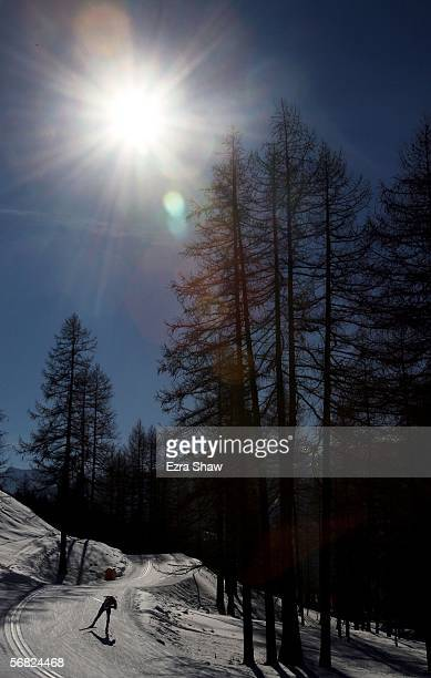 A biathlete skis in the Mens Biathlon 20km Individual Final on Day 1 of the 2006 Turin Winter Olympic Games on February 11 2006 in Cesana San Sicario...