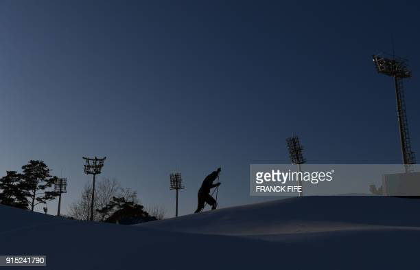 TOPSHOT A biathlete trains during a free practice session ahead of the Pyeongchang 2018 Winter Olympic Games in Pyeongchang on February 7 2018 / AFP...