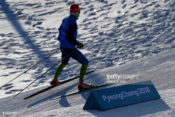 A biathlete trains during a free practice session ahead of the Pyeongchang 2018 Winter Olympic Games in Pyeongchang on February 7 2018 / AFP PHOTO /...