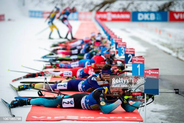 Biathletes compete at the shooting range during the Single Mixed Relay competition of the IBU Biathlon World Cup in Pokljuka on December 2 2018