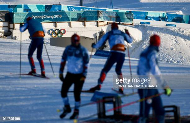 Biathletes practice during a training session ahead of the Pyeongchang 2018 Winter Olympic Games in Pyeongchang on February 6 2018 / AFP PHOTO /...