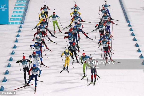 Biathletes set off at the start during the Men's 15km Mass Start Biathlon on day nine of the PyeongChang 2018 Winter Olympic Games at Alpensia...