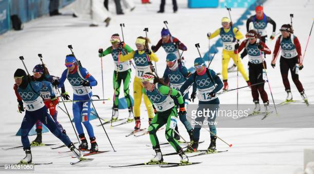 Biathletes set off at the start during the Women's 125km Mass Start Biathlon on day eight of the PyeongChang 2018 Winter Olympic Games at Alpensia...