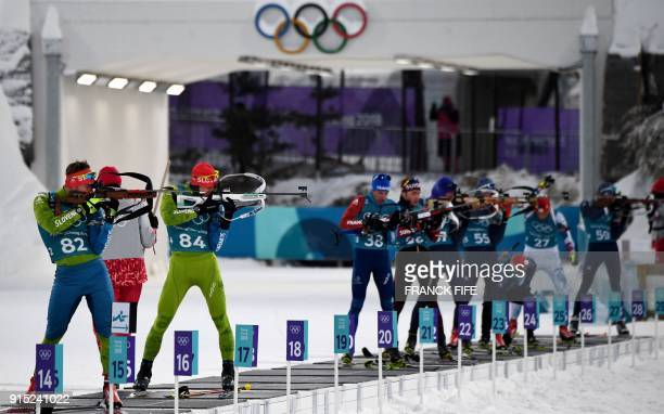 Biathletes shoot during a free practice session ahead of the Pyeongchang 2018 Winter Olympic Games in Pyeongchang on February 7 2018 / AFP PHOTO /...