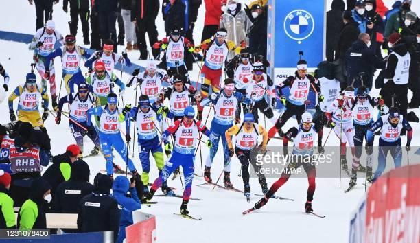 Biathletes take the start of the 4x7,5 km Mixed Relay event at the IBU Biathlon World Championships in Pokljuka, Slovenia, on February 10, 2021.