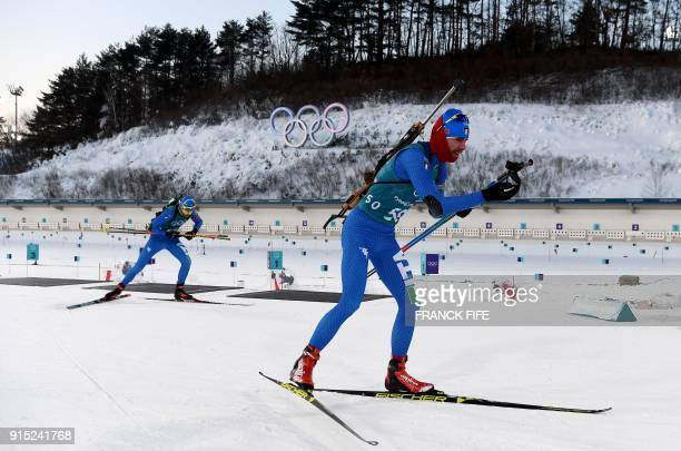 Biathletes train during a free practice session ahead of the Pyeongchang 2018 Winter Olympic Games in Pyeongchang on February 7 2018 / AFP PHOTO /...