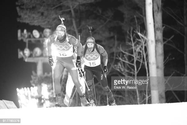 2018 Winter Olympics South Korea Timofey Lapshin and Switzerland Benjamin Weger in action during Men's 125km Pursuit at Alpensia CrossCountry Centre...
