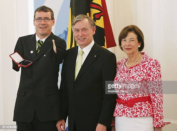 Biathlon athlete Josef Giesen receives an award from German President Horst Koehler and his wife Eva Koehler during the ceremony of the 'Silbernes...