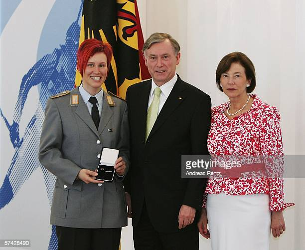 Biathlon athlete Kati Wilhelm receives an award from German President Horst Koehler and his wife Eva Koehler during the ceremony of the 'Silbernes...
